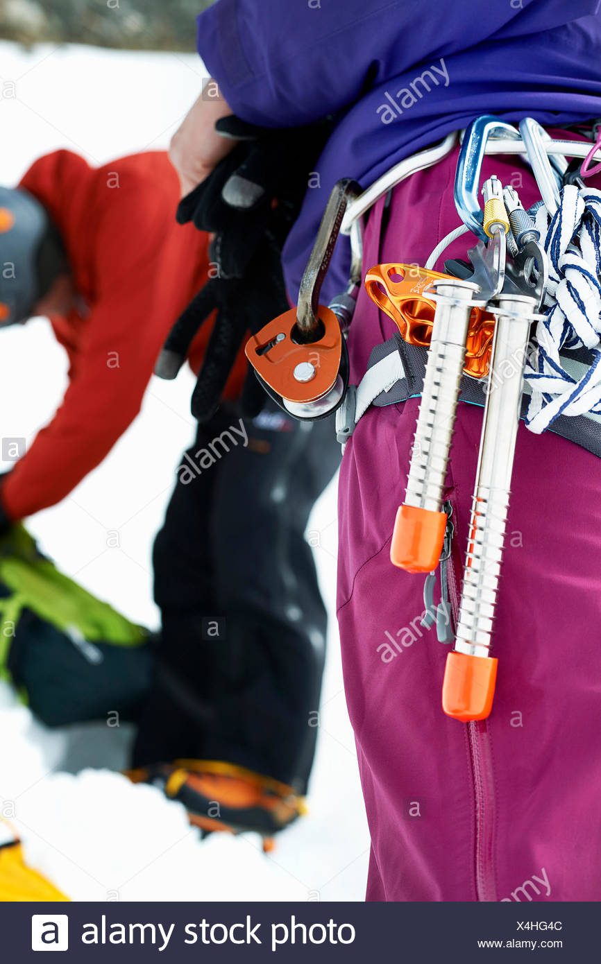Close up of mountaineering equipment on mountaineers harness - Stock Image