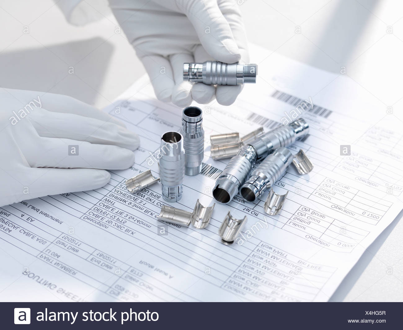 Hands holding electronic parts - Stock Image