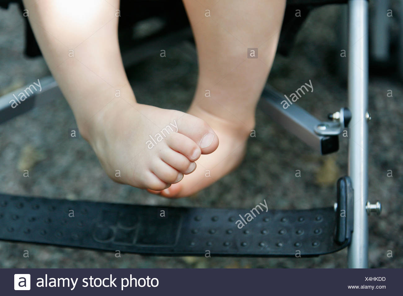 Baby (12-17 months) in baby stroll - Stock Image
