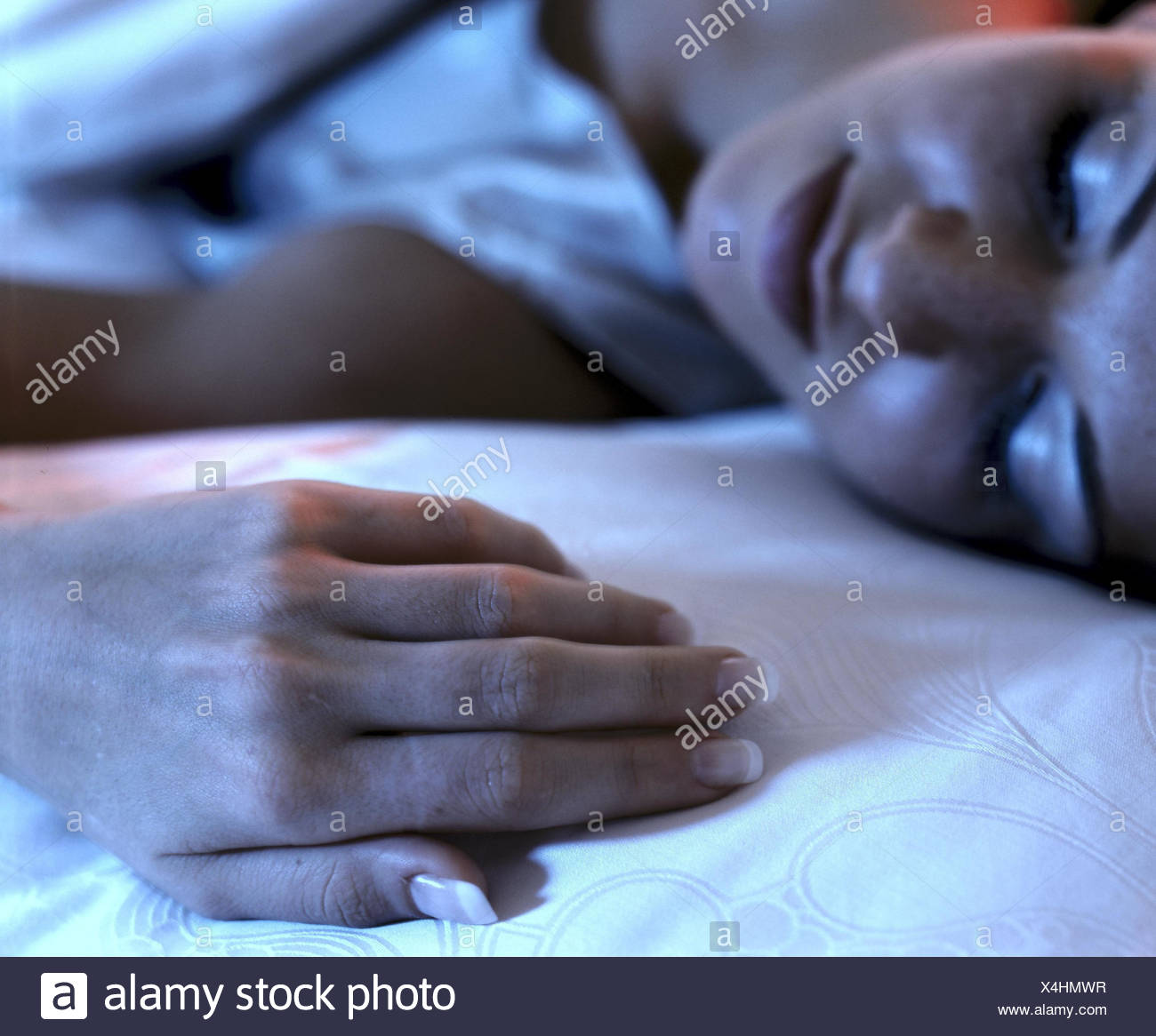 Bed, woman, sleep, relax detail bedroom, sleep, fatigue, tiredly, depletion, détente, recover, rest, rest, get a good night's sleep, beauty sleep, deep sleep, silence, night's rest - Stock Image