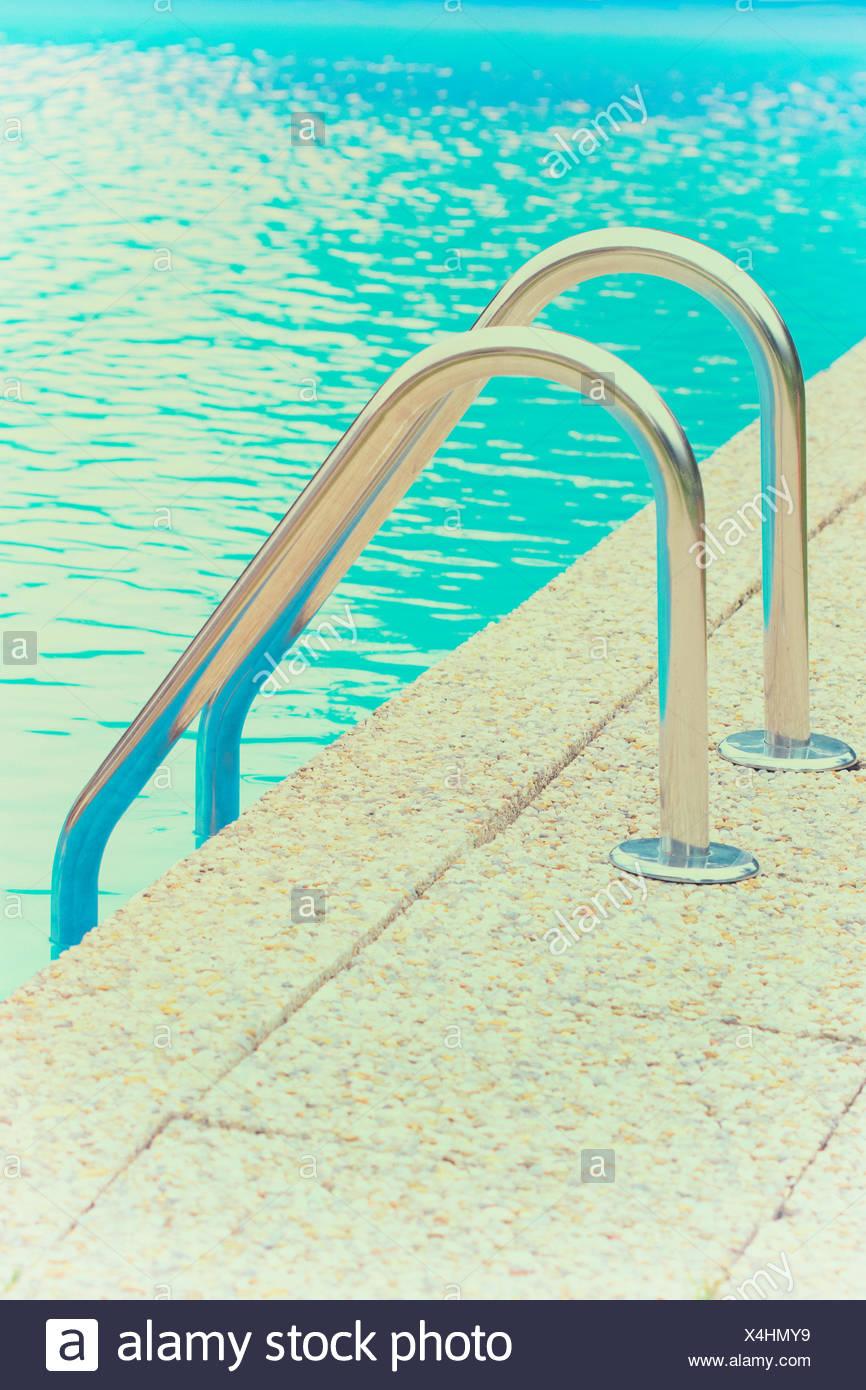 Swimming pool railings ladder steps chrome rail Stock Photo ...