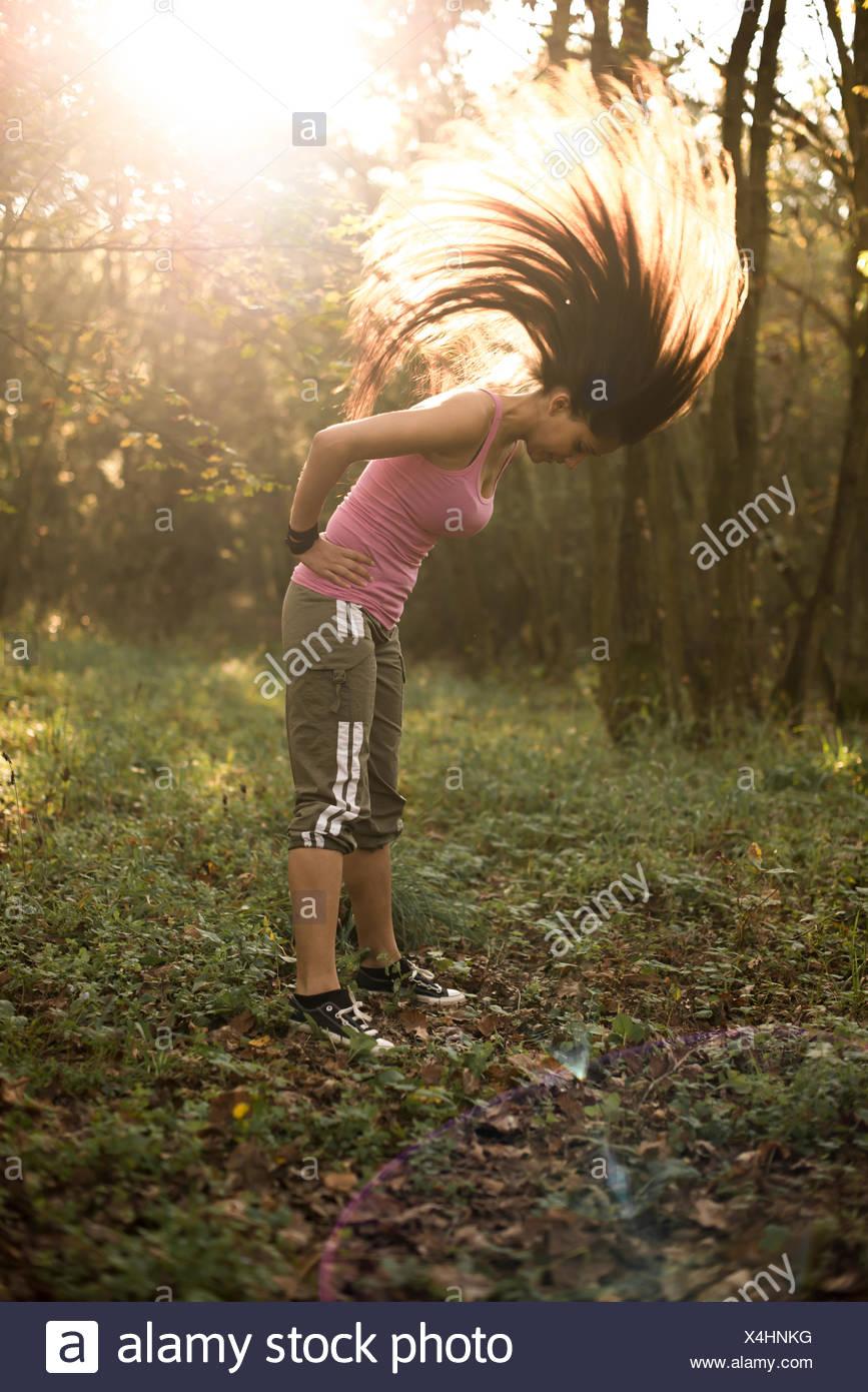 Young sportive woman in open oak tree forest, near Vienna, Austria, Lower Austria (model-released) - Stock Image