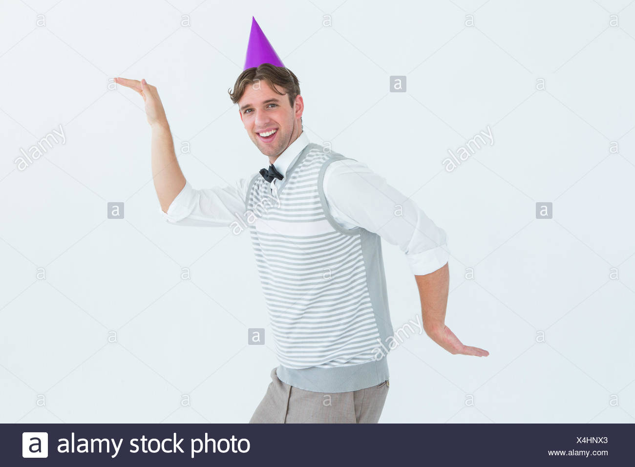 Happy geeky hipster dancing - Stock Image