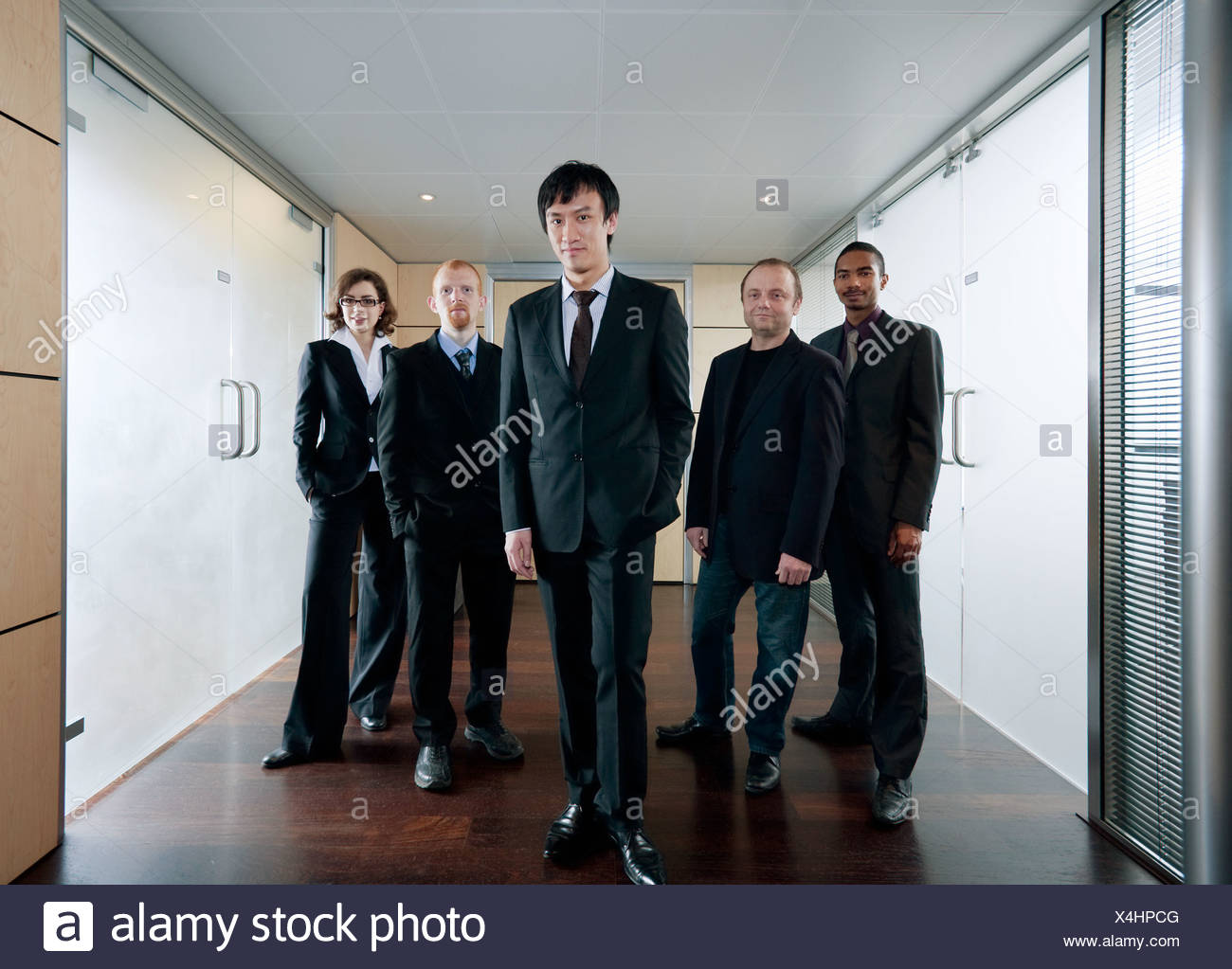 Chinese businessman and his team - Stock Image