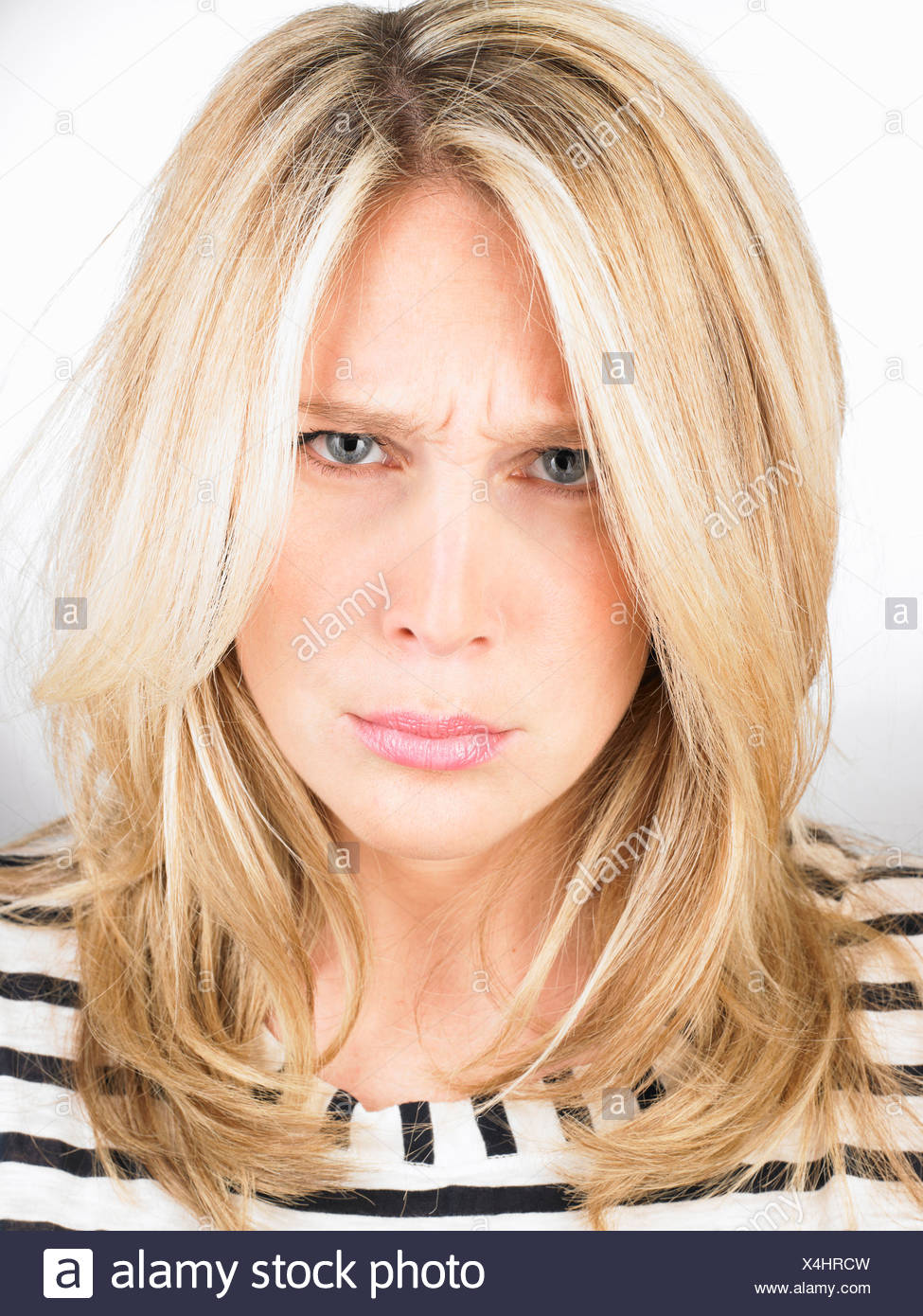 Woman scowling - Stock Image