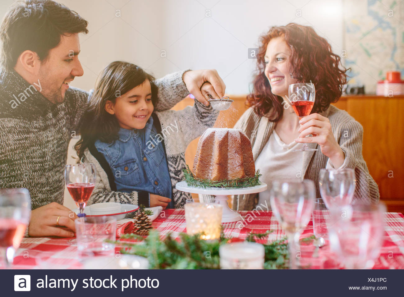 Woman serving desert at family Christmas party - Stock Image