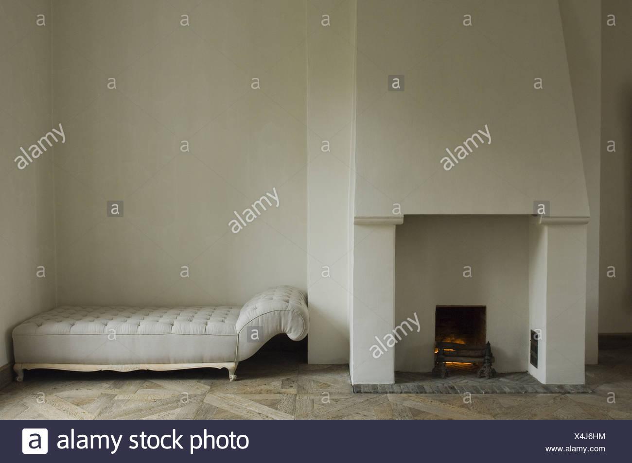 chimney and sofa - Stock Image