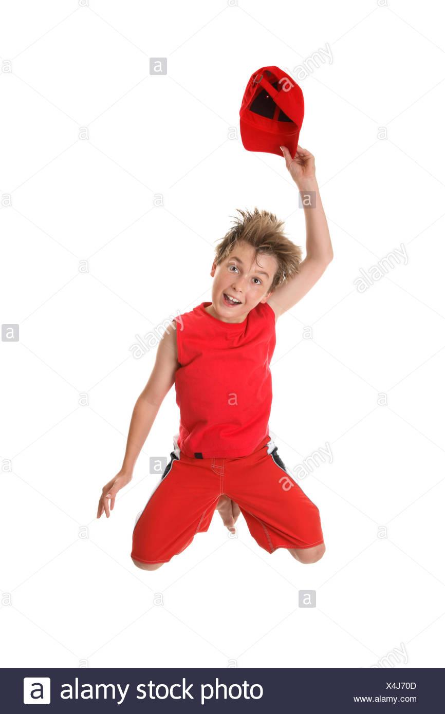 Spirited Happy Boy Jumping Stock Photo