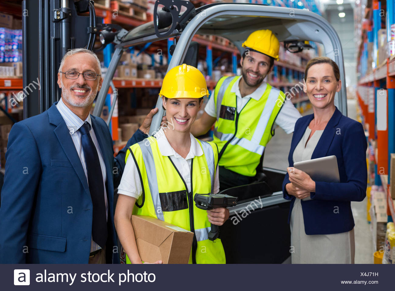 Businessman controlling digital device of worker - Stock Image