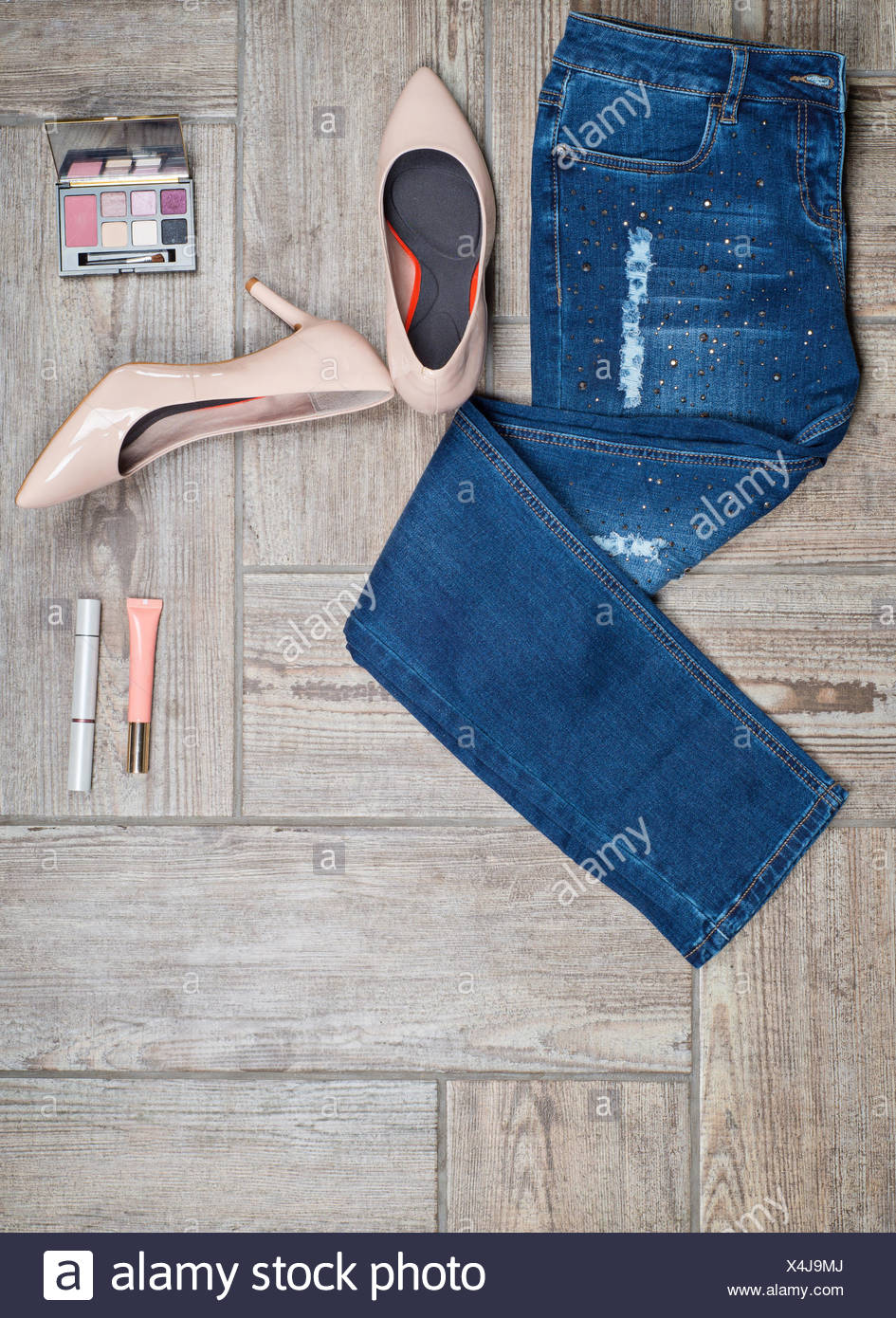 Flat lay photo of girl&#39 s jeans and accessories Stock Photo