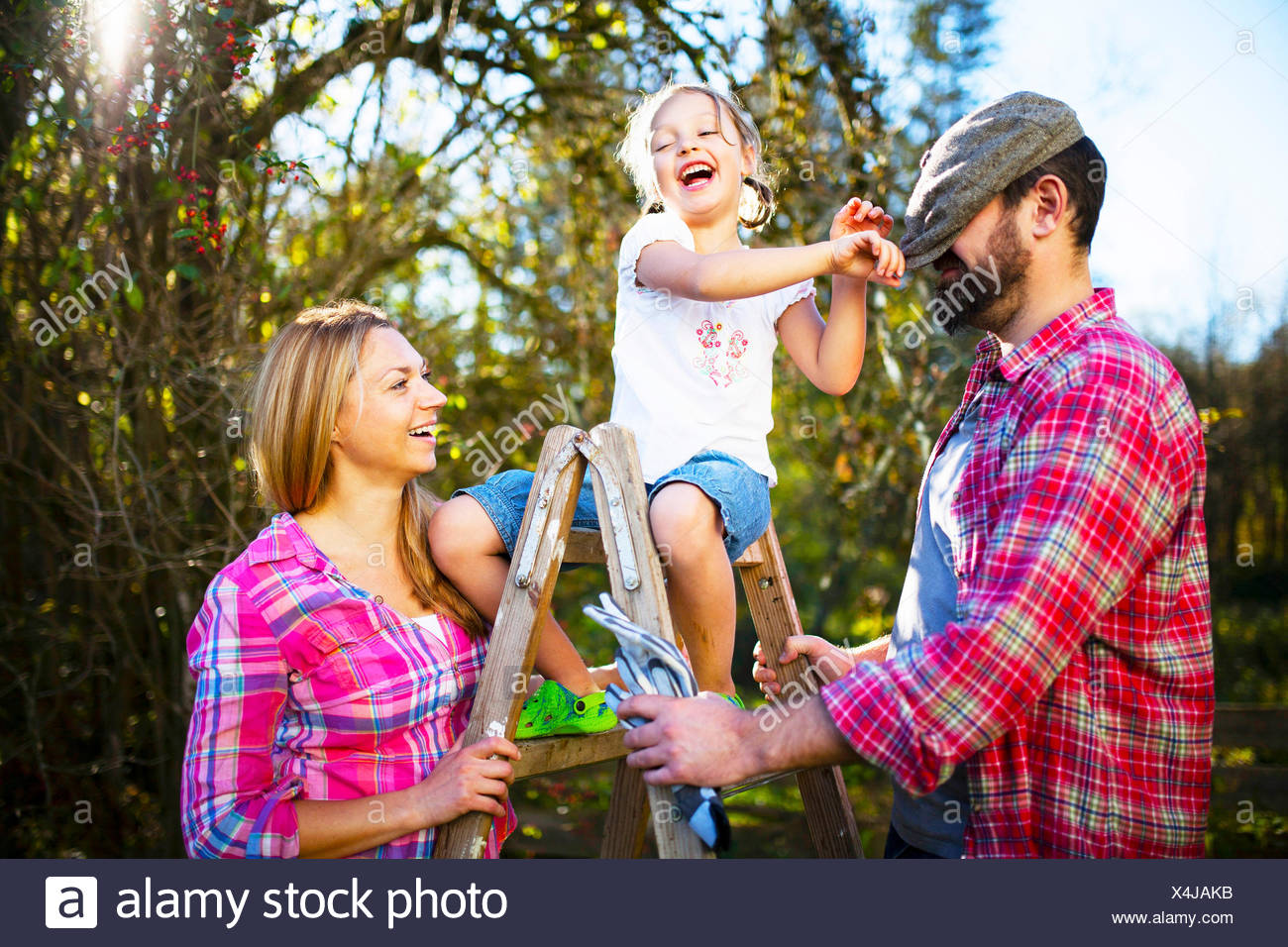 Family having fun in the garden, Munich, Bavaria, Germany - Stock Image