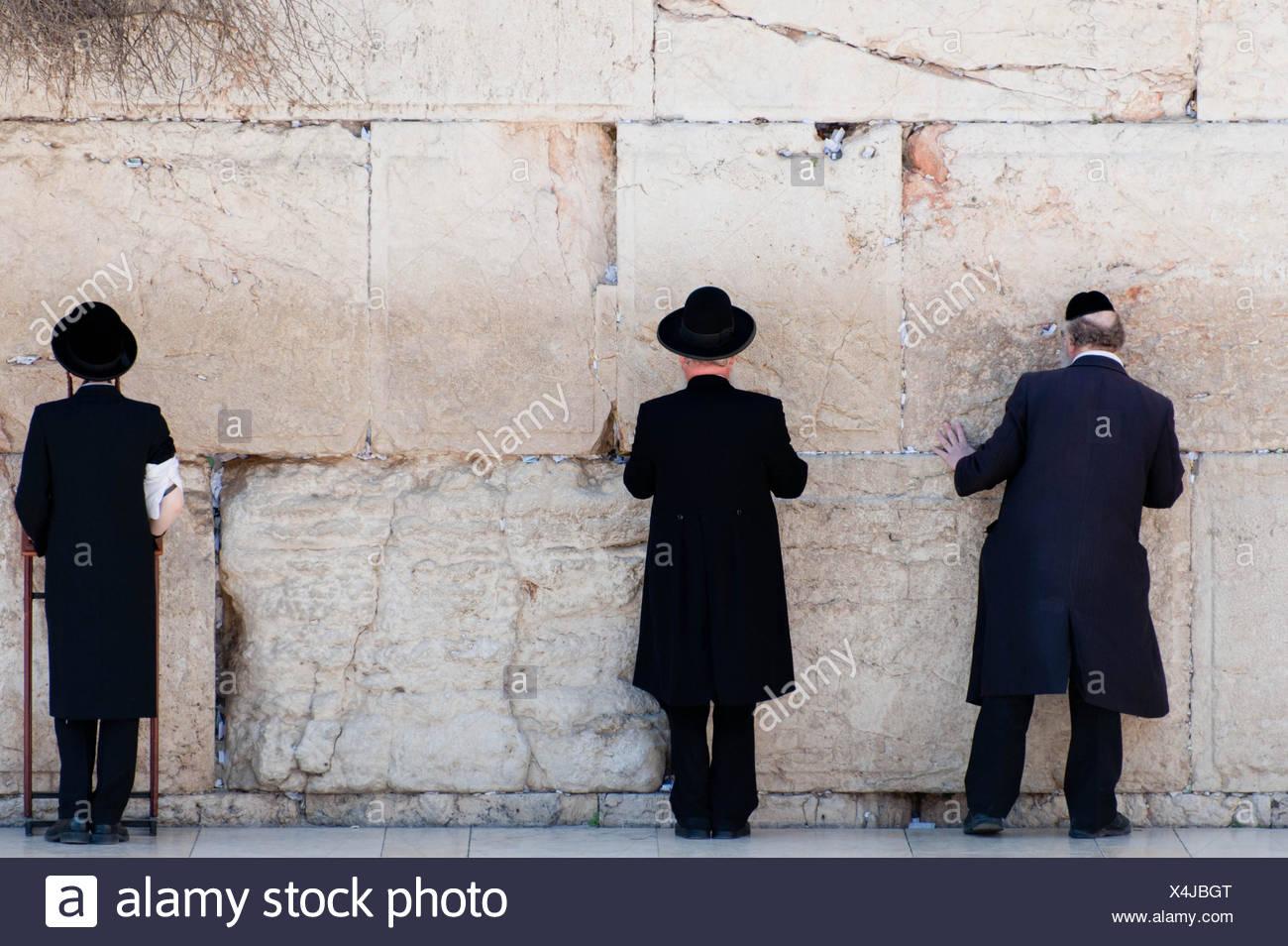 Orthodox Jewish Men Praying At The Wailing Wall - Stock Image