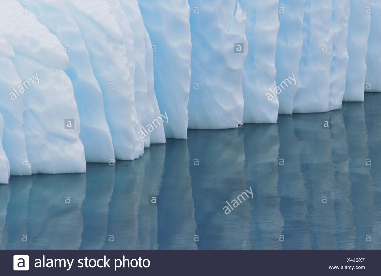Iceberg reflection. Paradise Bay. Antartica - Stock Image