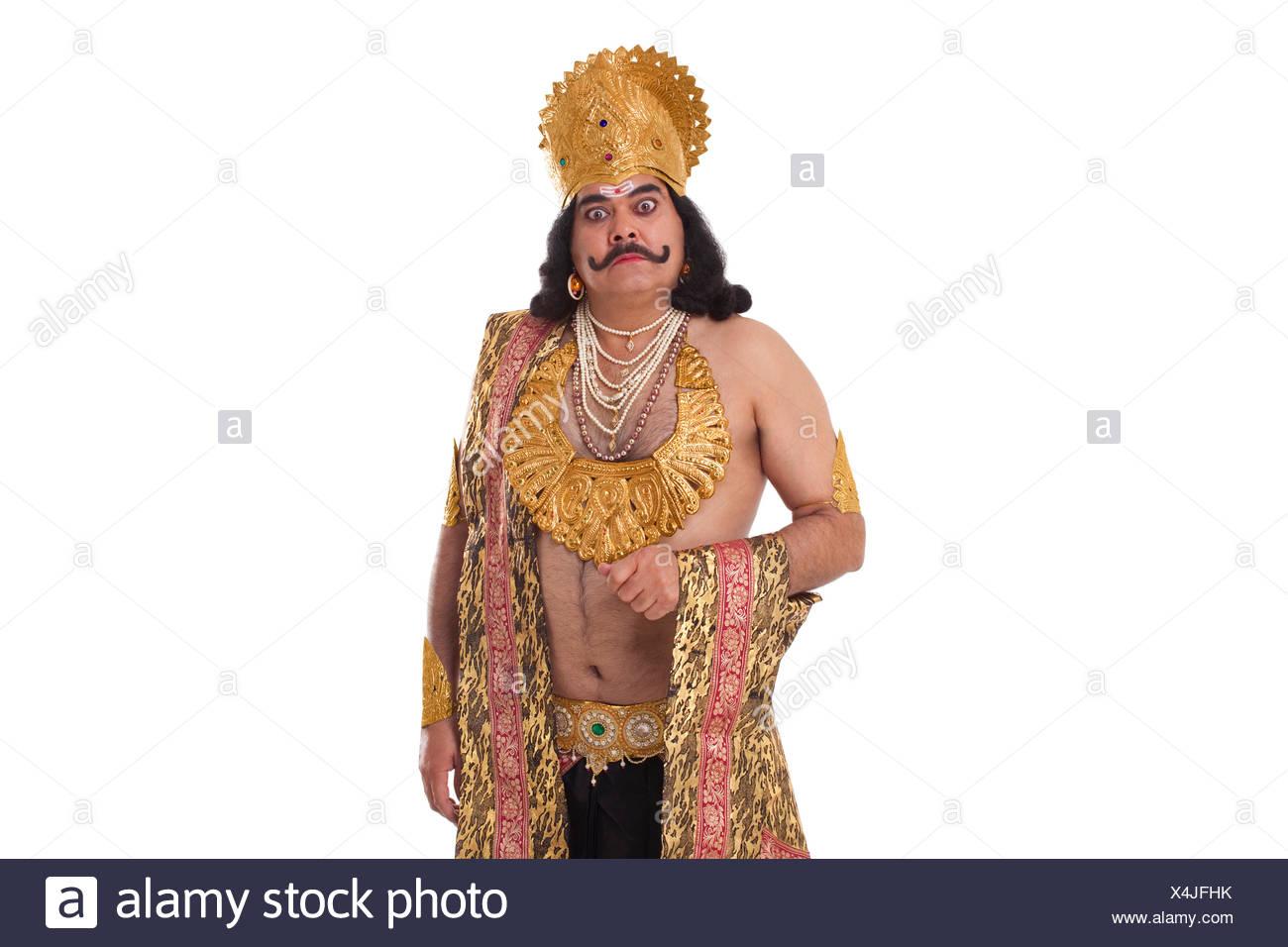 Man dressed as Raavan looking serious - Stock Image