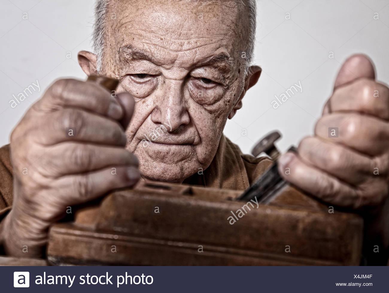 ol man at work - Stock Image