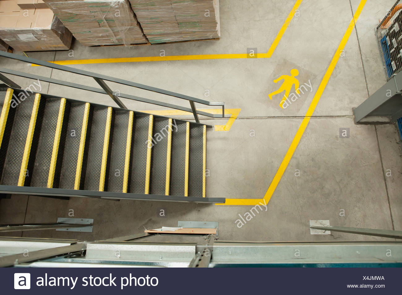 Steps and yellow lines in warehouse, elevated view - Stock Image