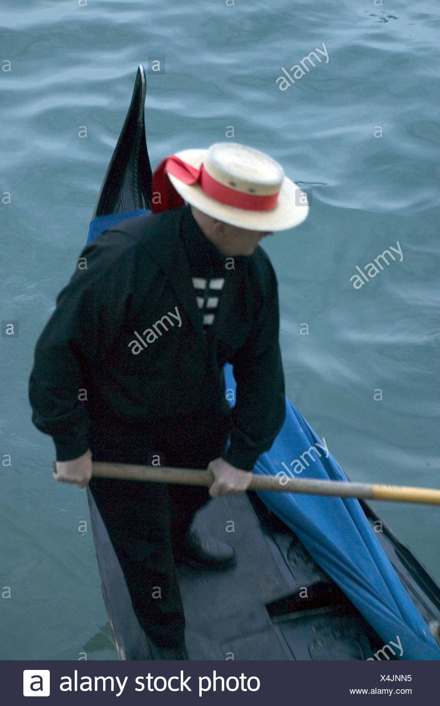 d205ee8f0c8 Gondolier with red ribbon straw hat on stern of gondola Stock Photo ...