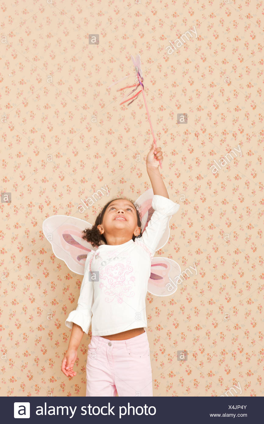 Girl in fairy costume with wand - Stock Image