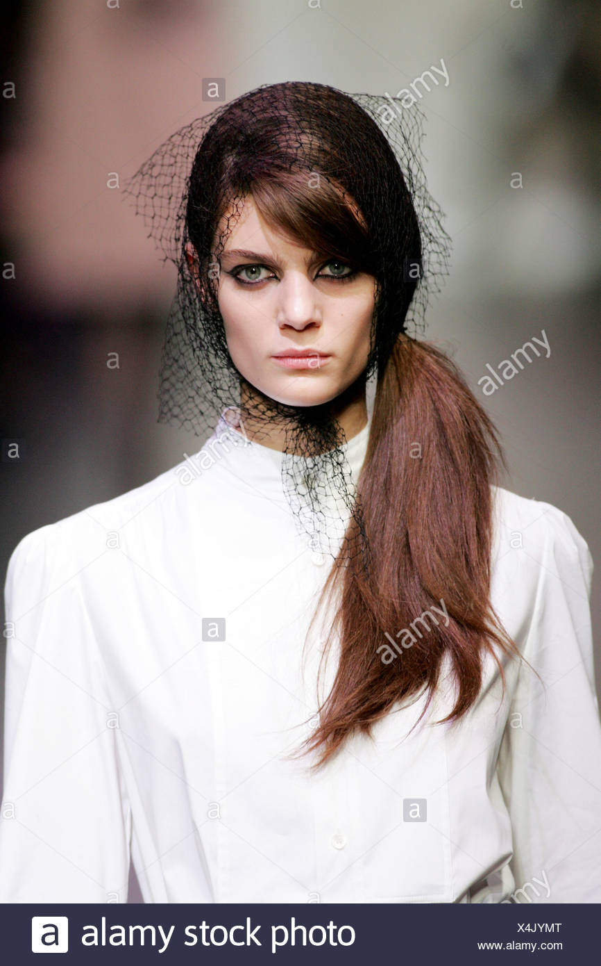 6fc636db63cb Miu Miu Milan Ready to Wear Autumn Winter Side ponytail and net scarf -  Stock Image