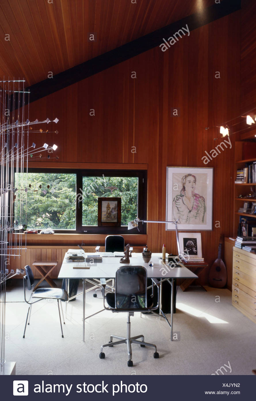 Image of: Room Wood Panel Walls And High Ceiling Artwork On Wall Modern Style Table And Chairs Bookshelves And Mandolin On Floor Stock Photo Alamy