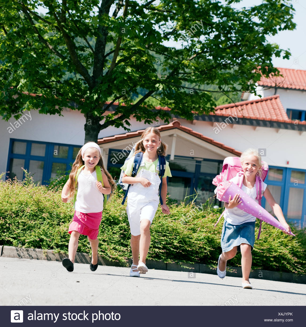 three schoolchildren having fun - Stock Image