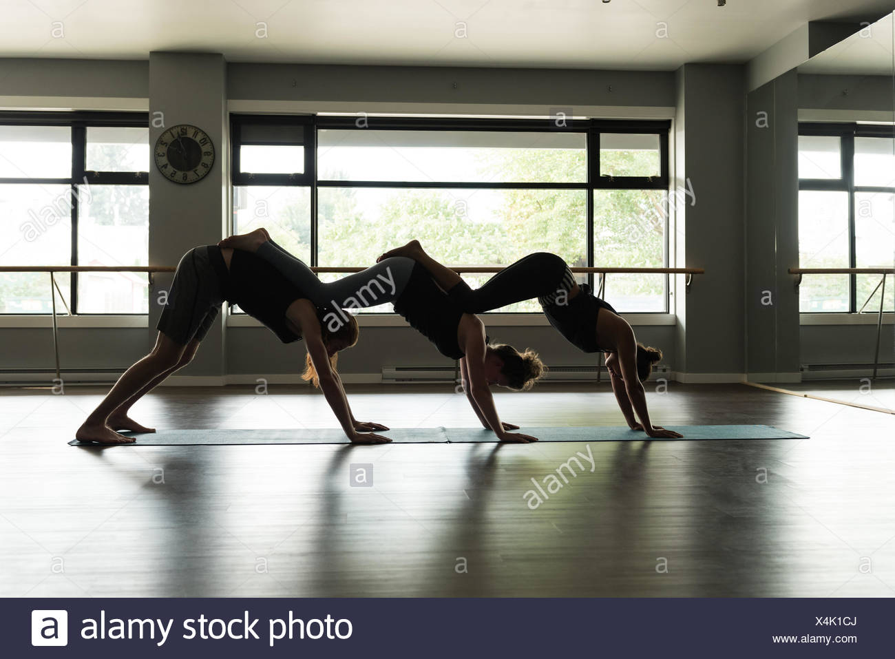 Group of fit people practicing acroyoga - Stock Image