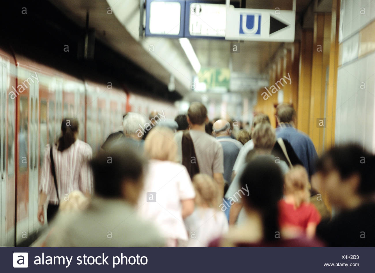 Subway stop, underground, platform, passengers, back view, railway station, stop, station, railway, means transportation, publicly, rail transports, transport, promotion, transportation human beings, train connection, occupational commuter, commuter, crowd people, Rushhour, train, trajectory - Stock Image