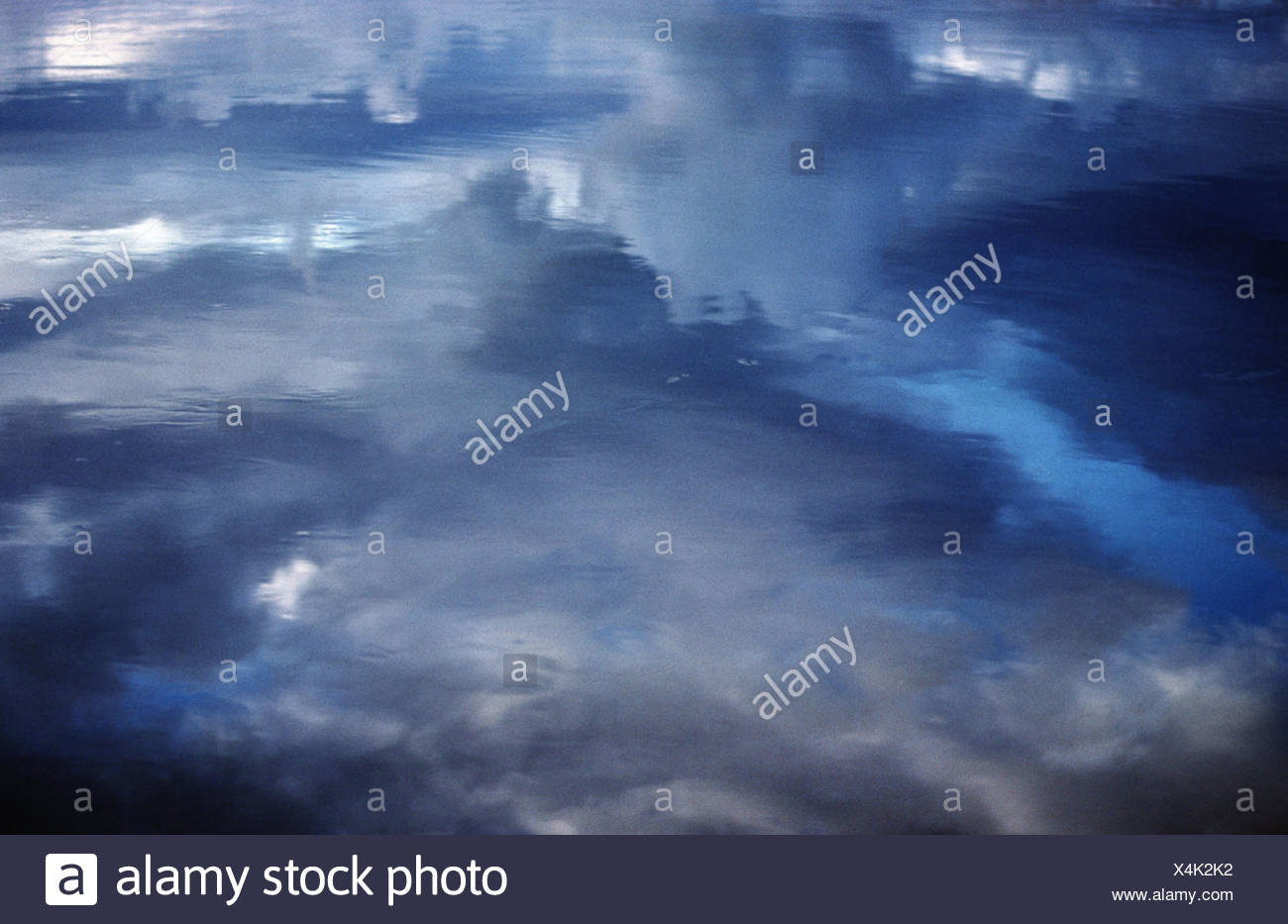 cloud reflexion on water surface, Iceland - Stock Image