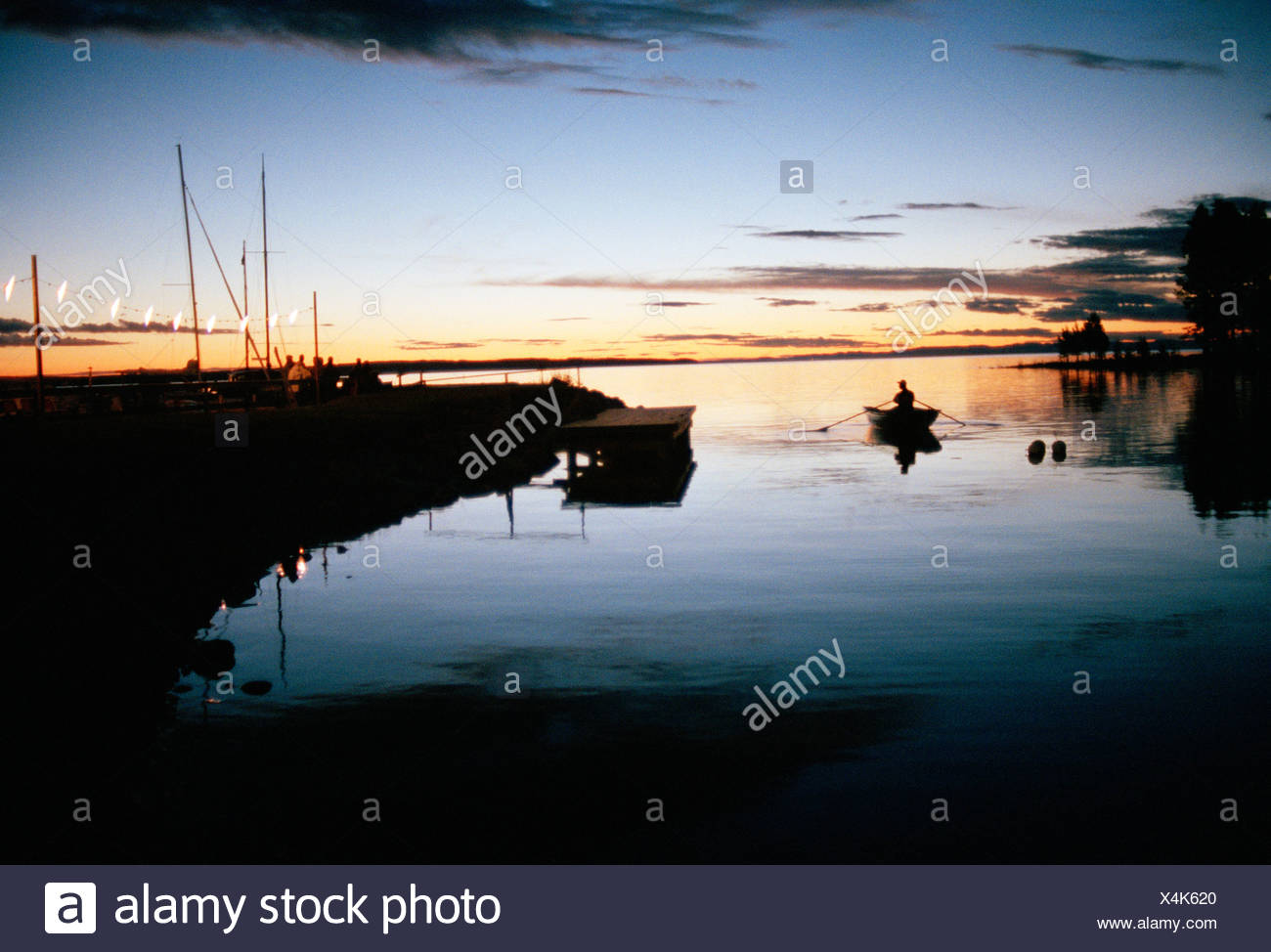 A boat in the evening, Sweden. - Stock Image