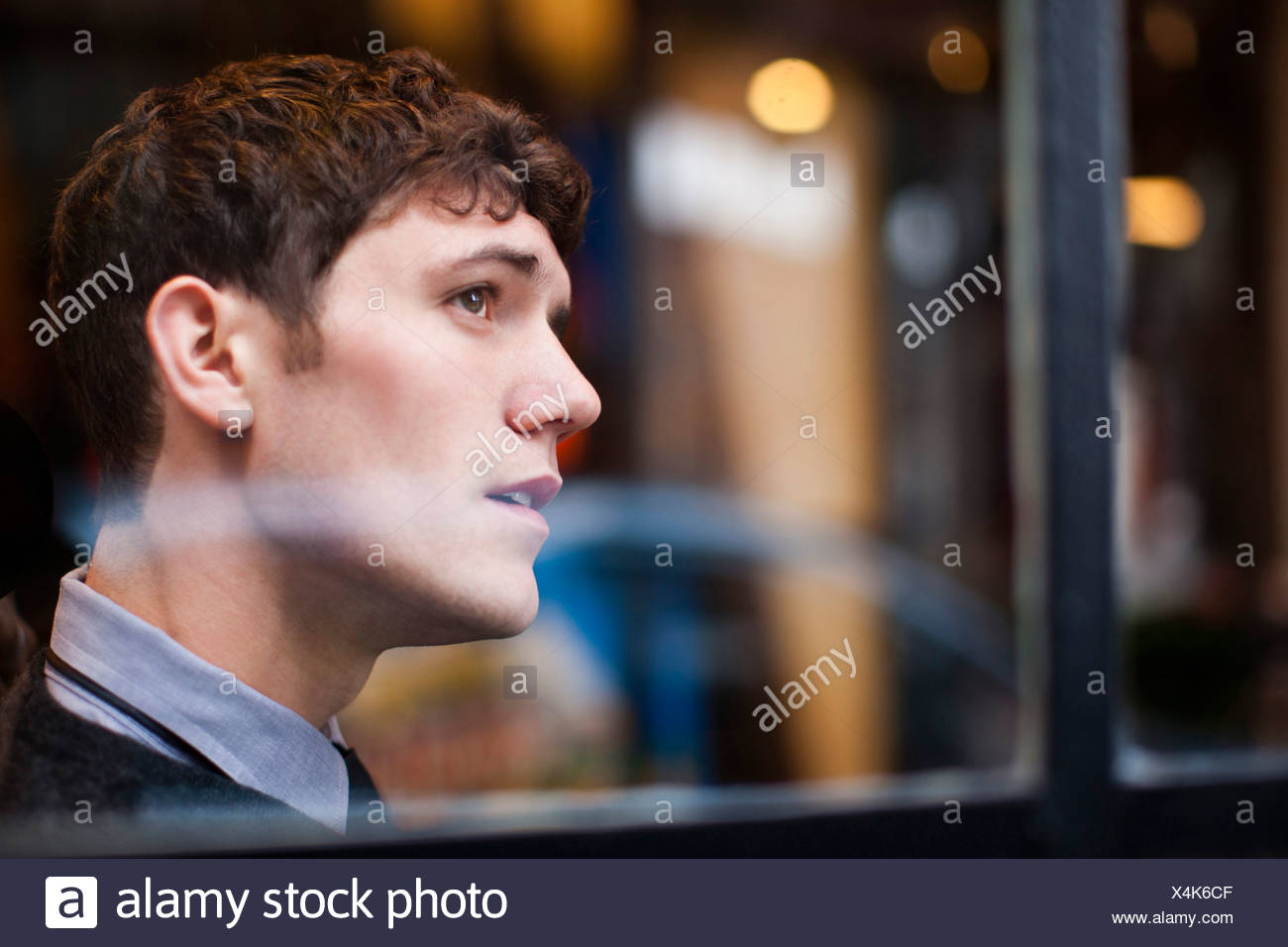 Businessman looking out window - Stock Image