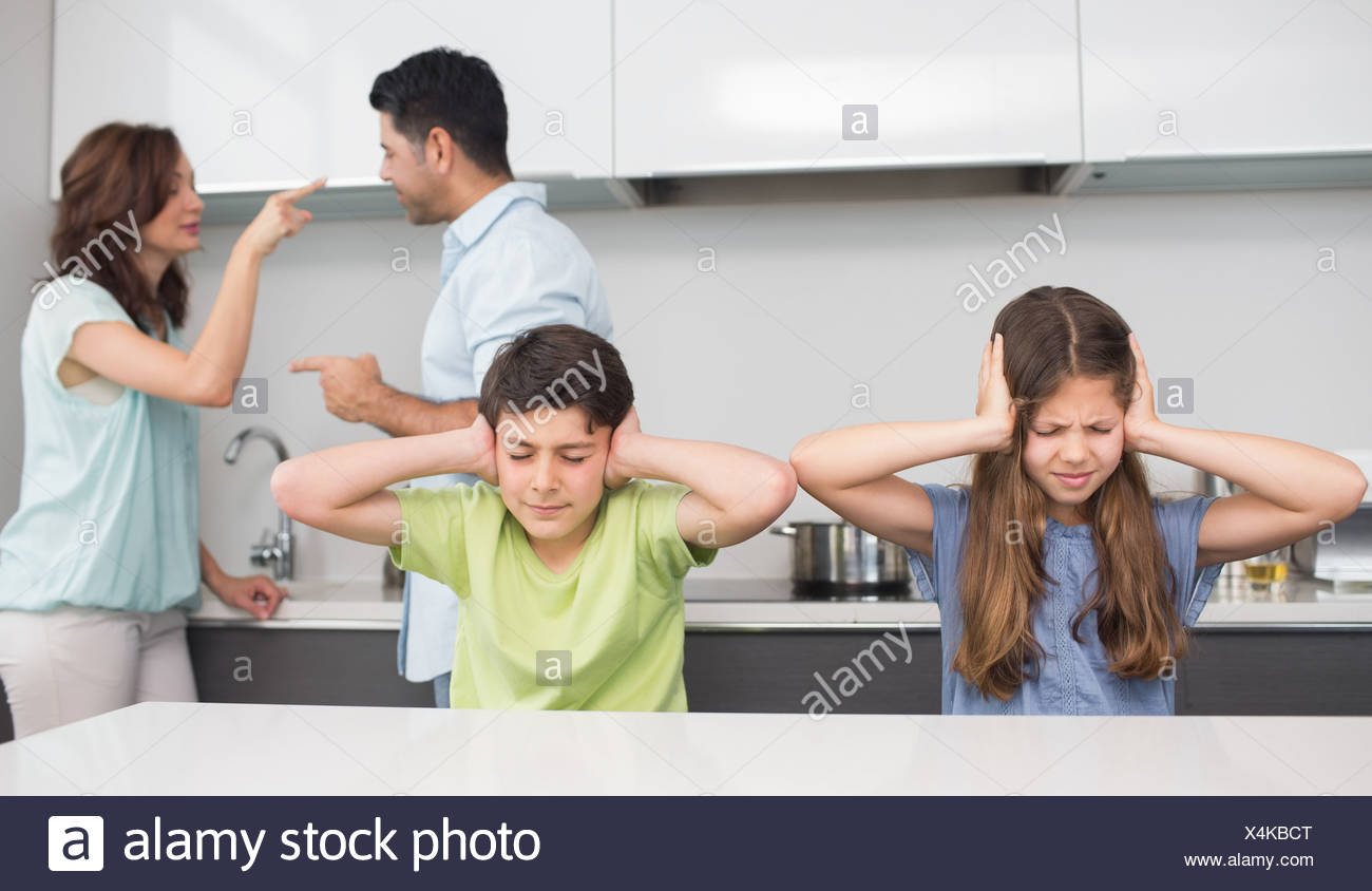 Sad young kids while parents quarreling - Stock Image