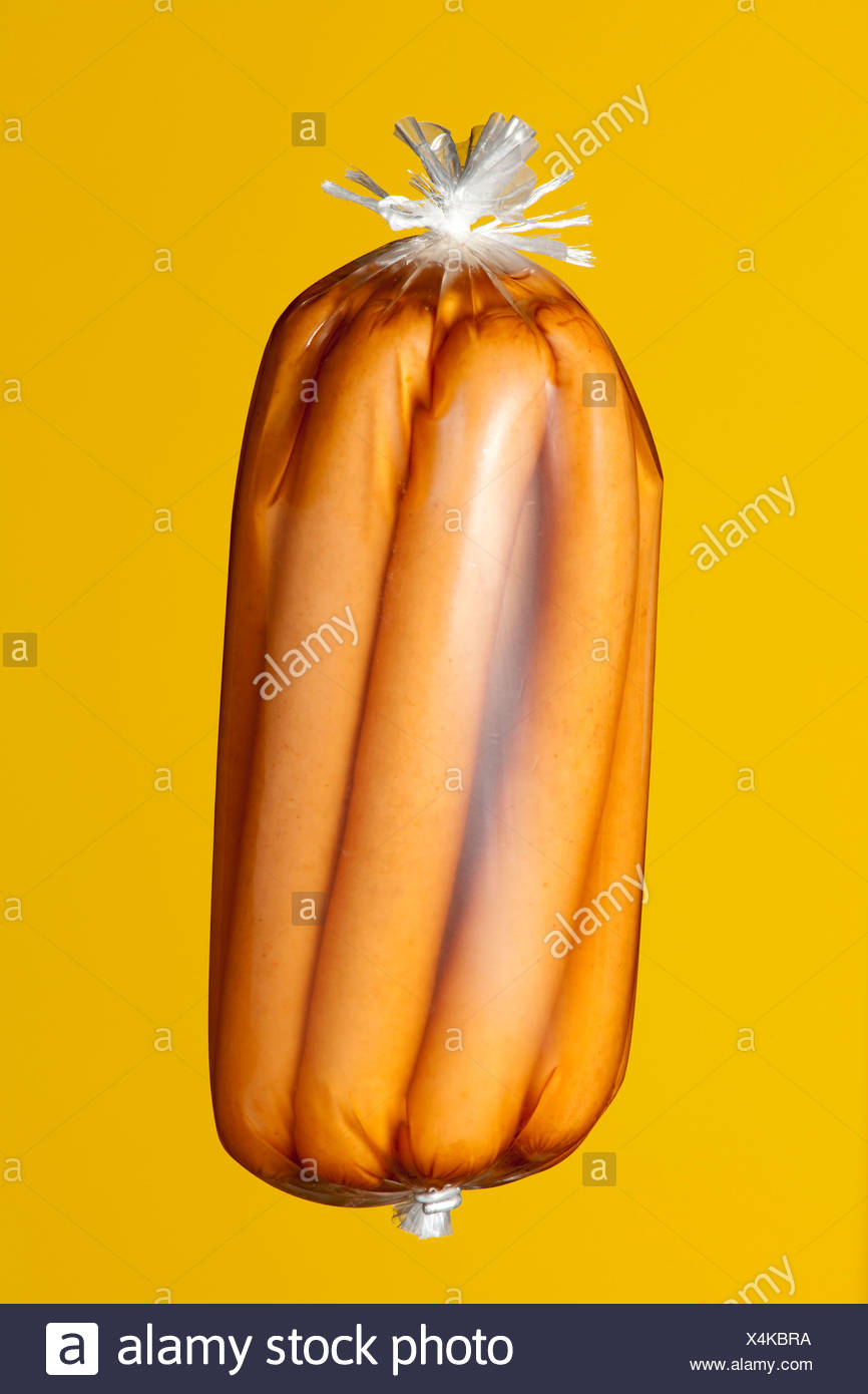 Conserved sausages in transparent plastic wrapping - Stock Image