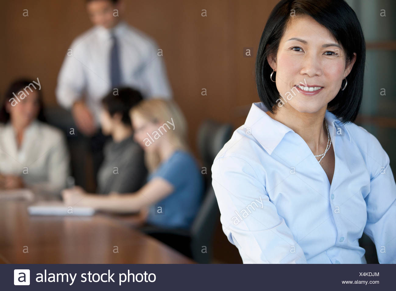 discussion with small group of coworkers - Stock Image