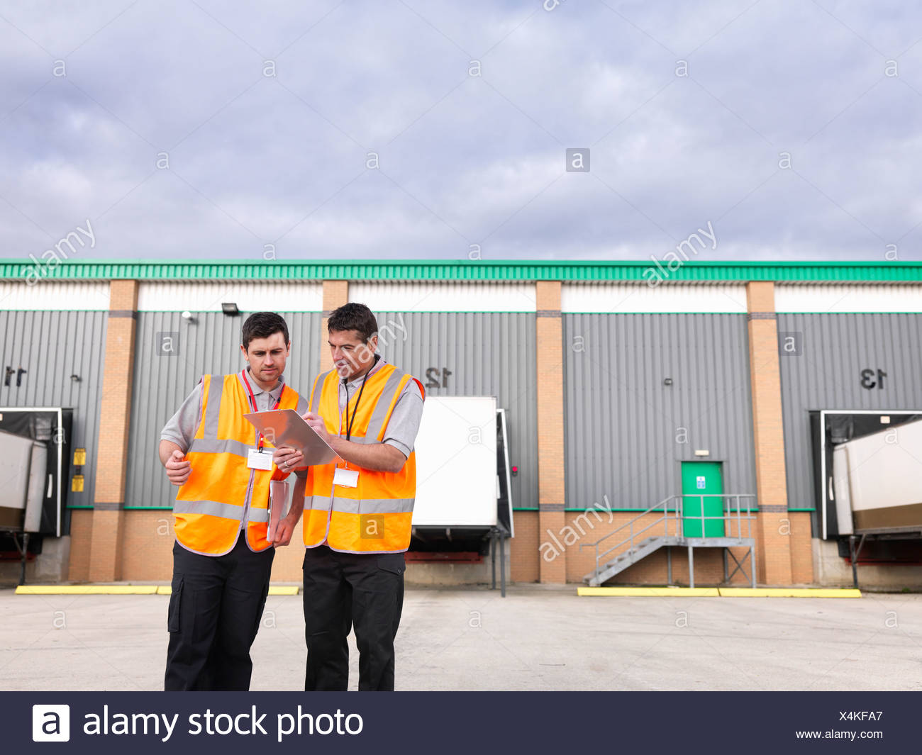 Workers in truck loading yard - Stock Image