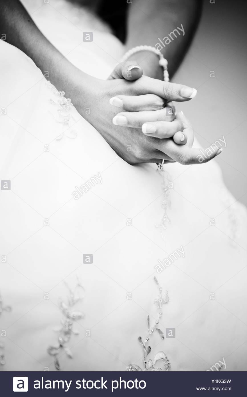 brides hands together - Stock Image