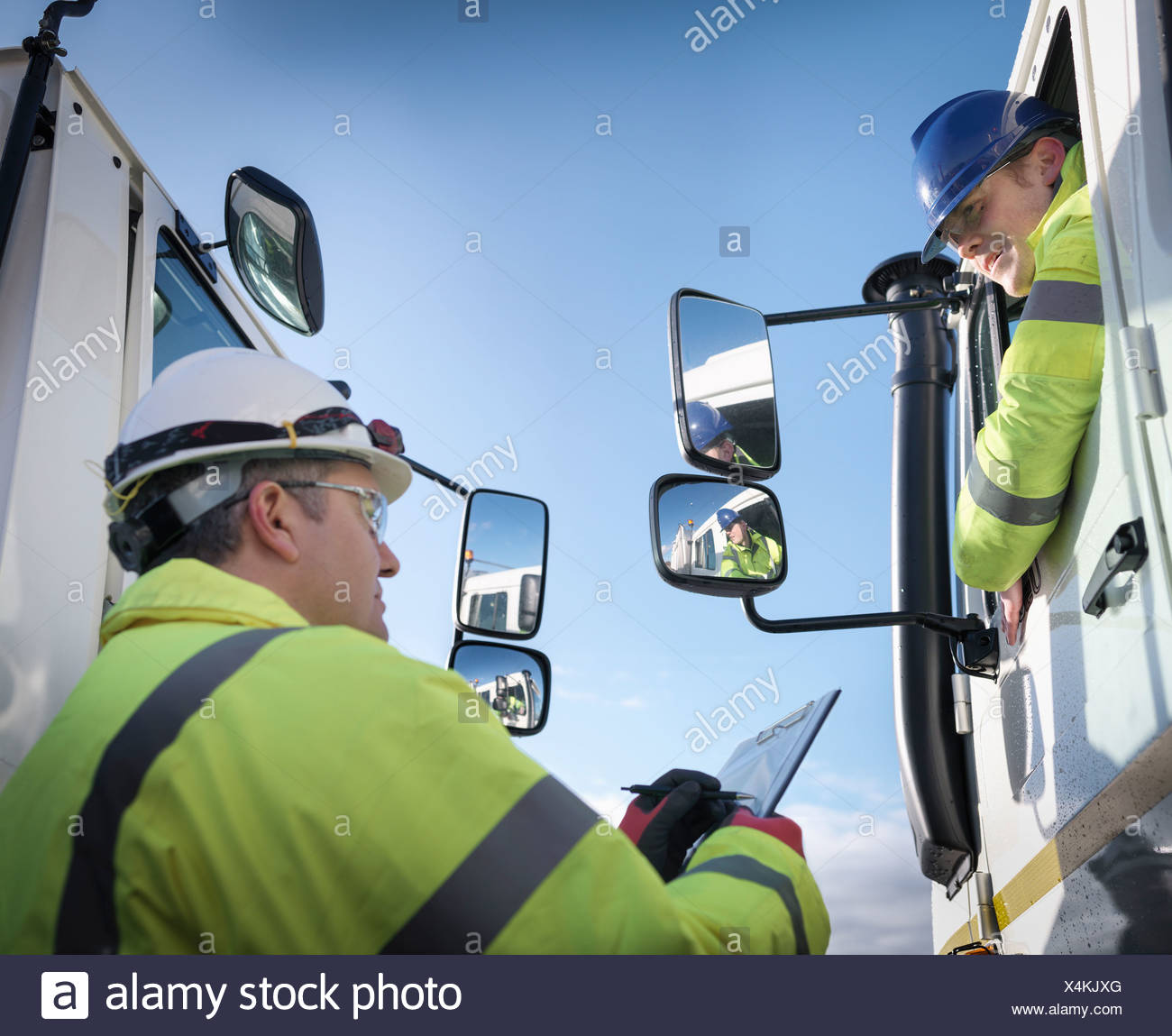 Emergency Response workers with specialist equipment and rescue trucks - Stock Image