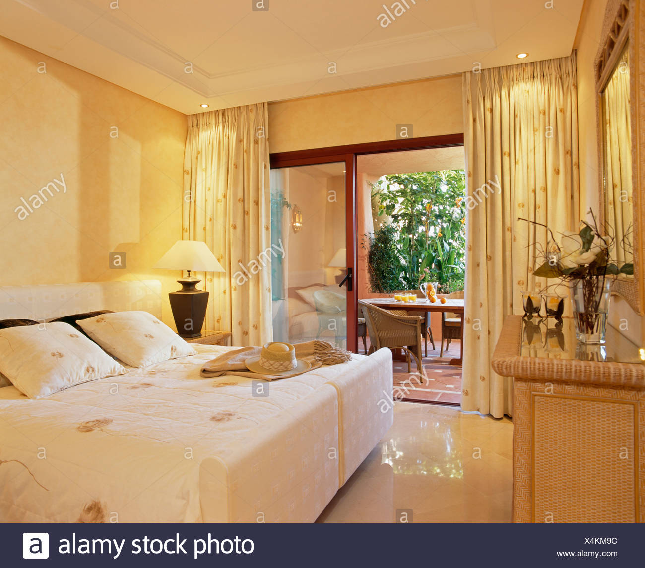 Lighting above cream curtains at open patio doors to balcony ...