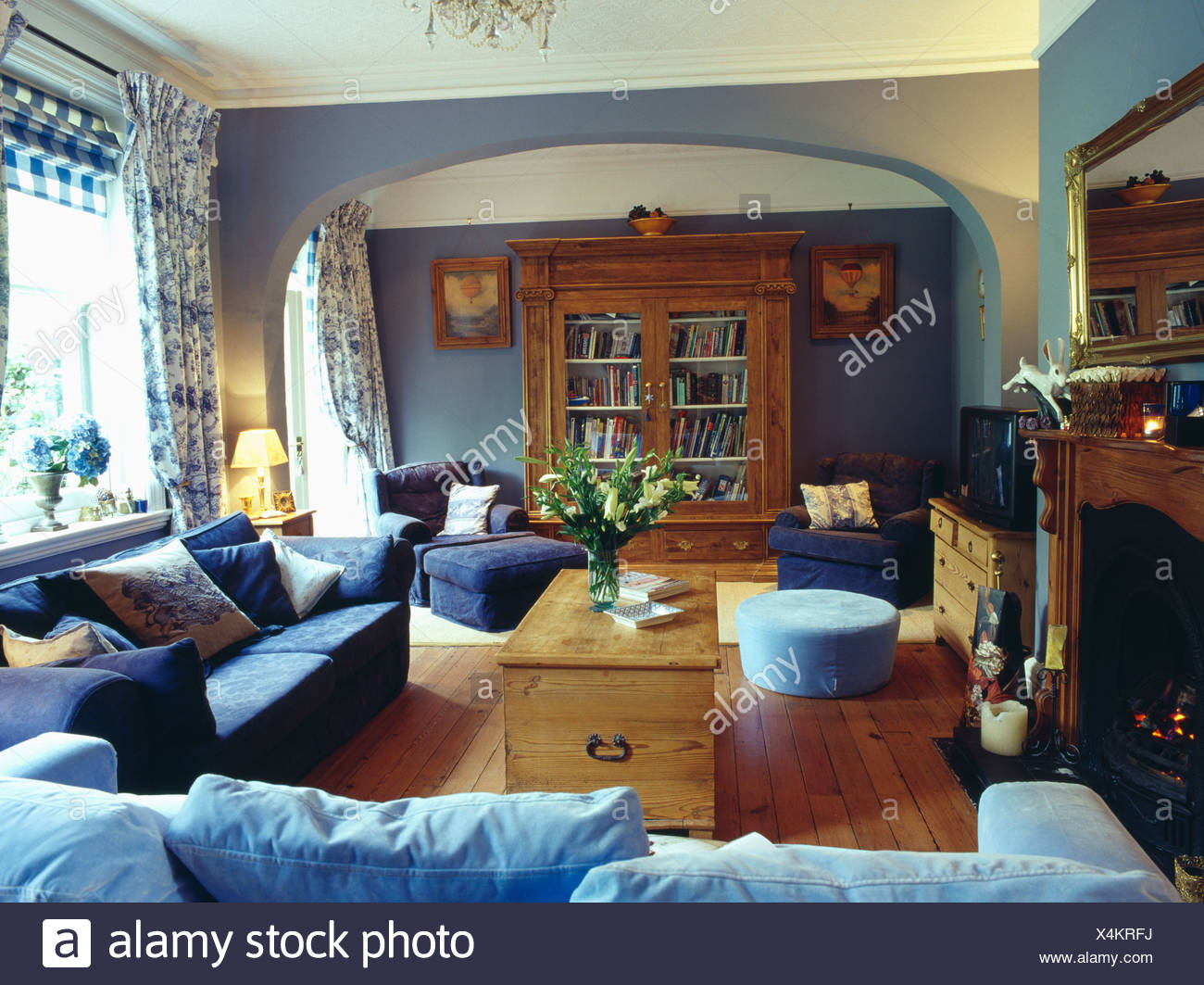 Pale blue and dark blue sofas and pine chest in pale blue living ...