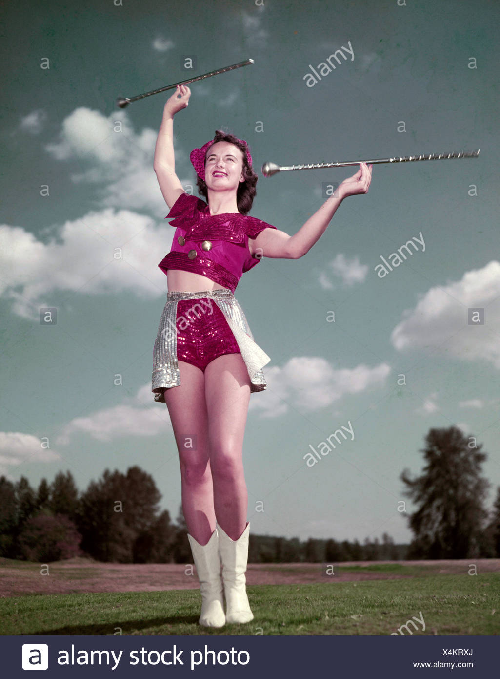 Low angle view of majorette twirling baton - Stock Image