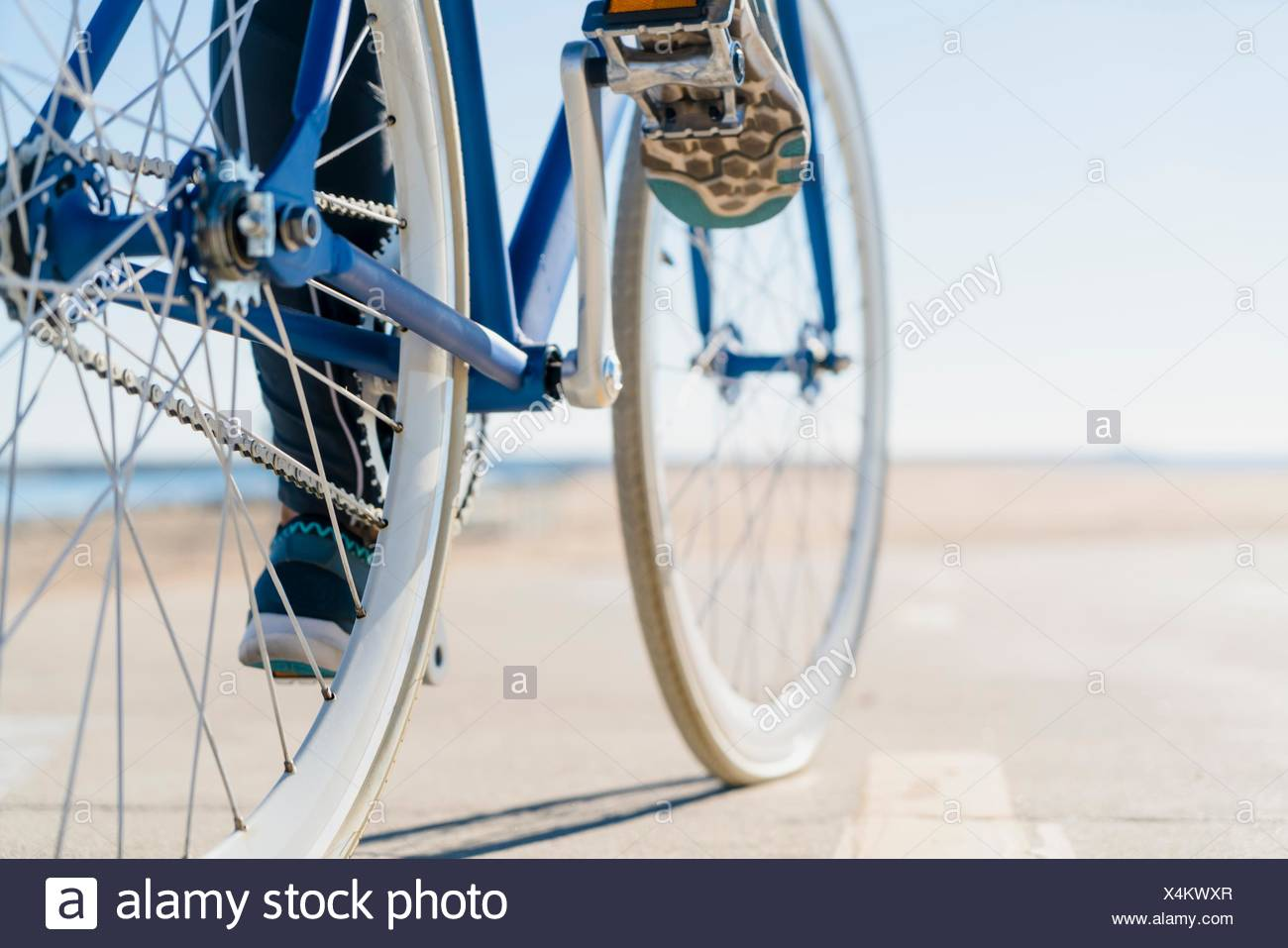 Woman cycling, low section, close-up - Stock Image