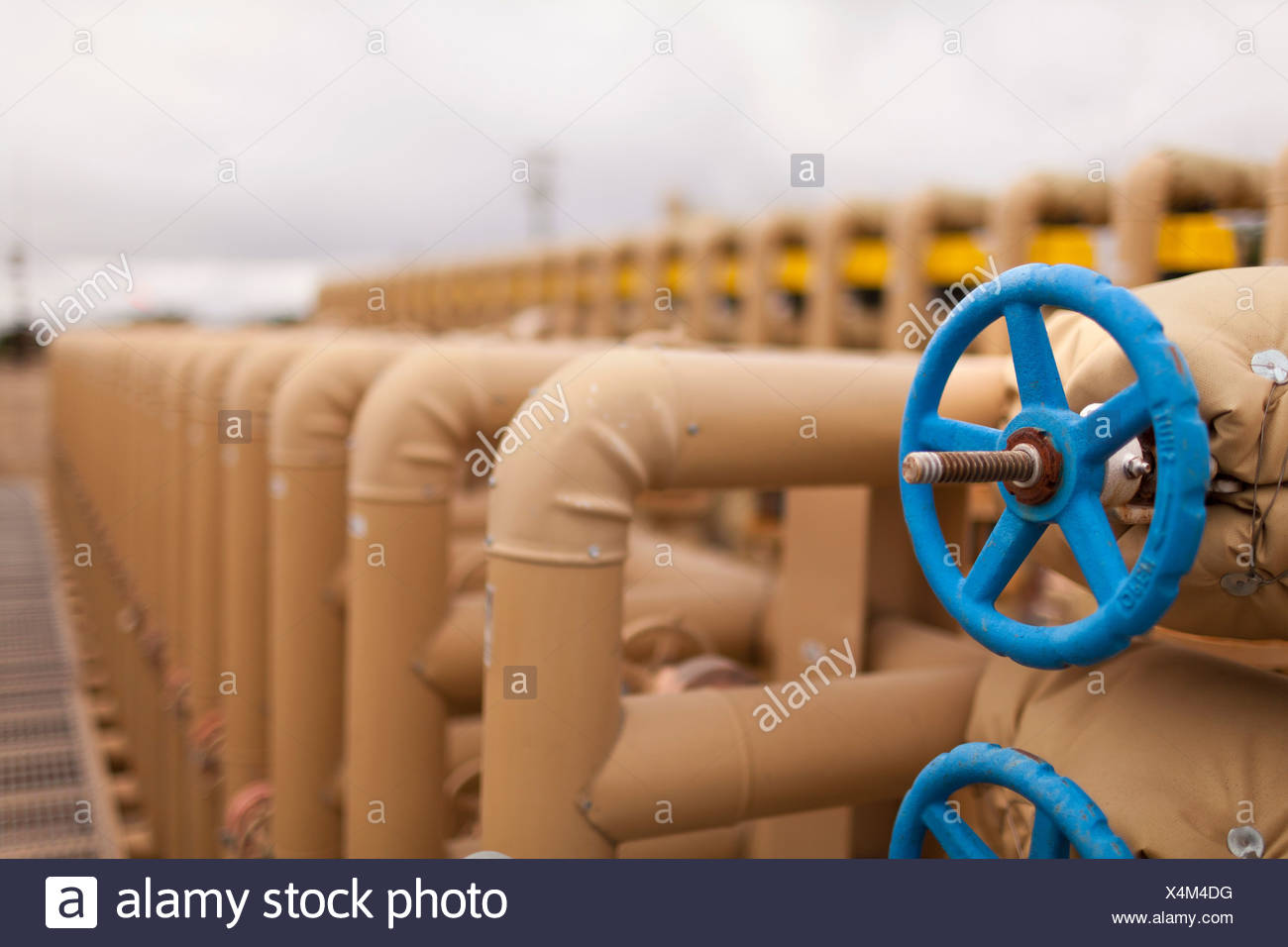 Fuel pipes in oil field, close up Stock Photo