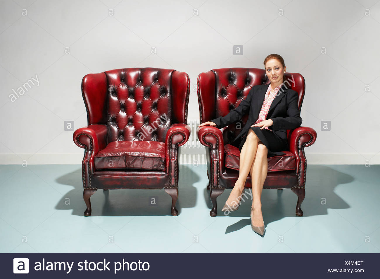 Businesswoman in a comfy leather chair - Stock Image