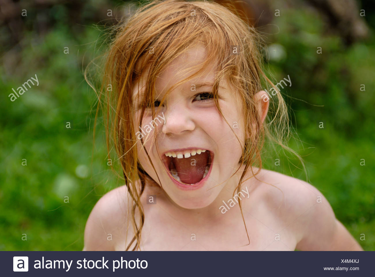 Little girl cries shouts screams very loud - Stock Image