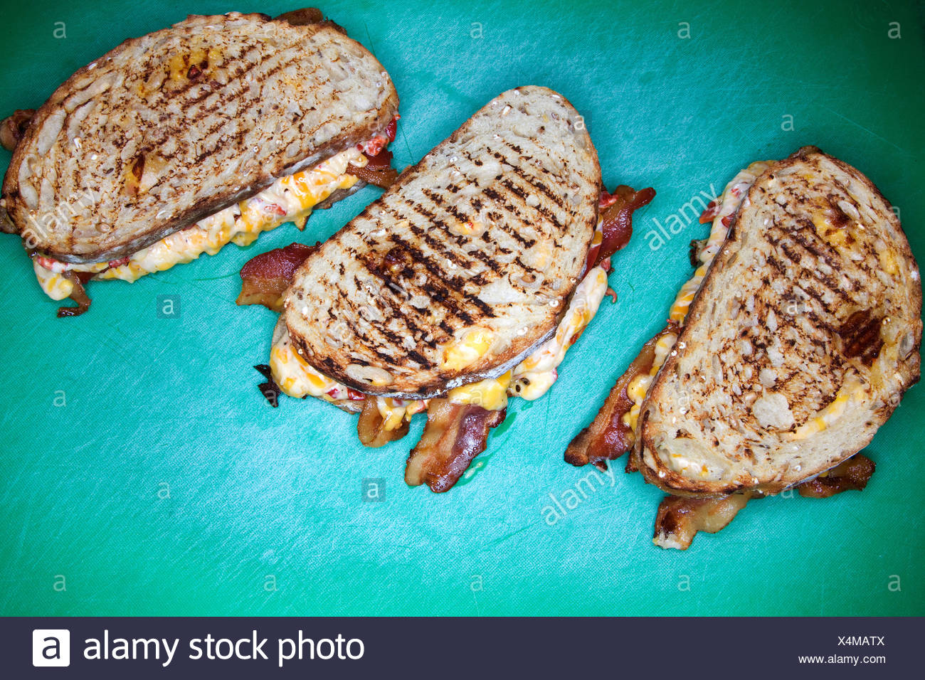 Three grilled cheese sandwiches - Stock Image