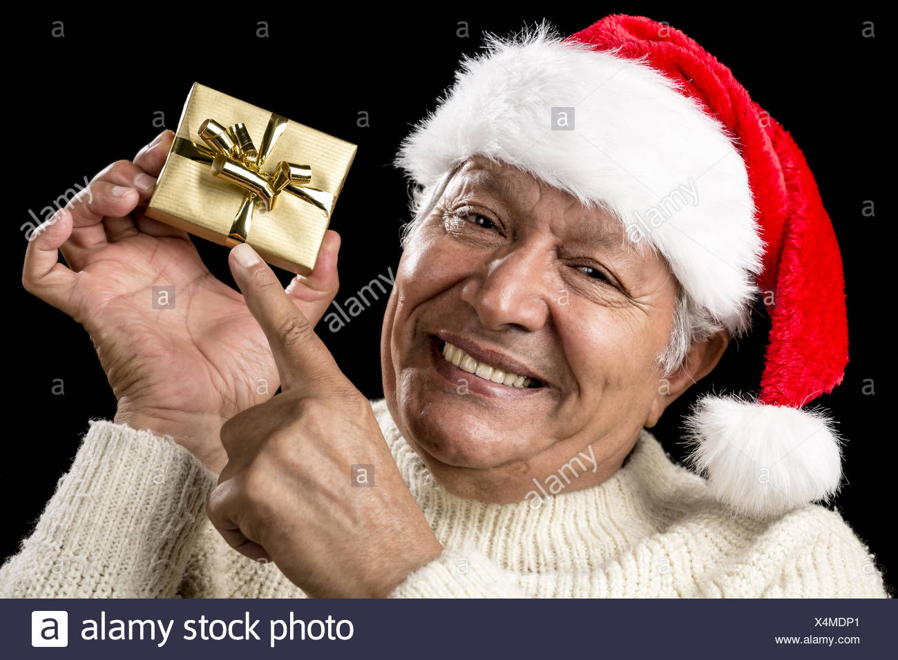 Playful Male Pensioner Pointing At Golden Gift - Stock Image