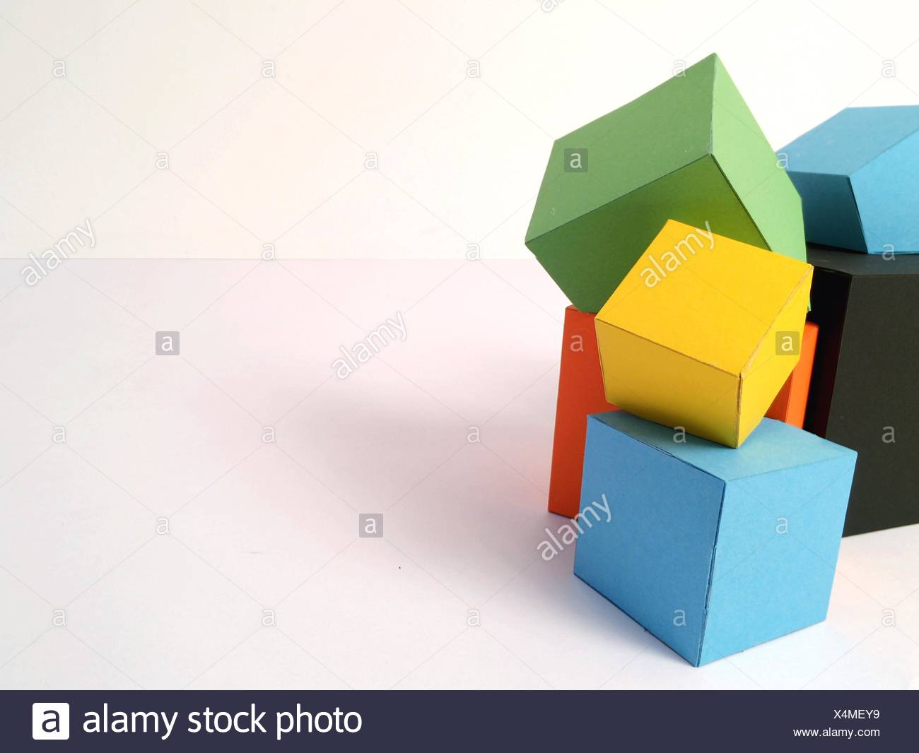 Multi Colored Cardboard Boxes On White Background - Stock Image