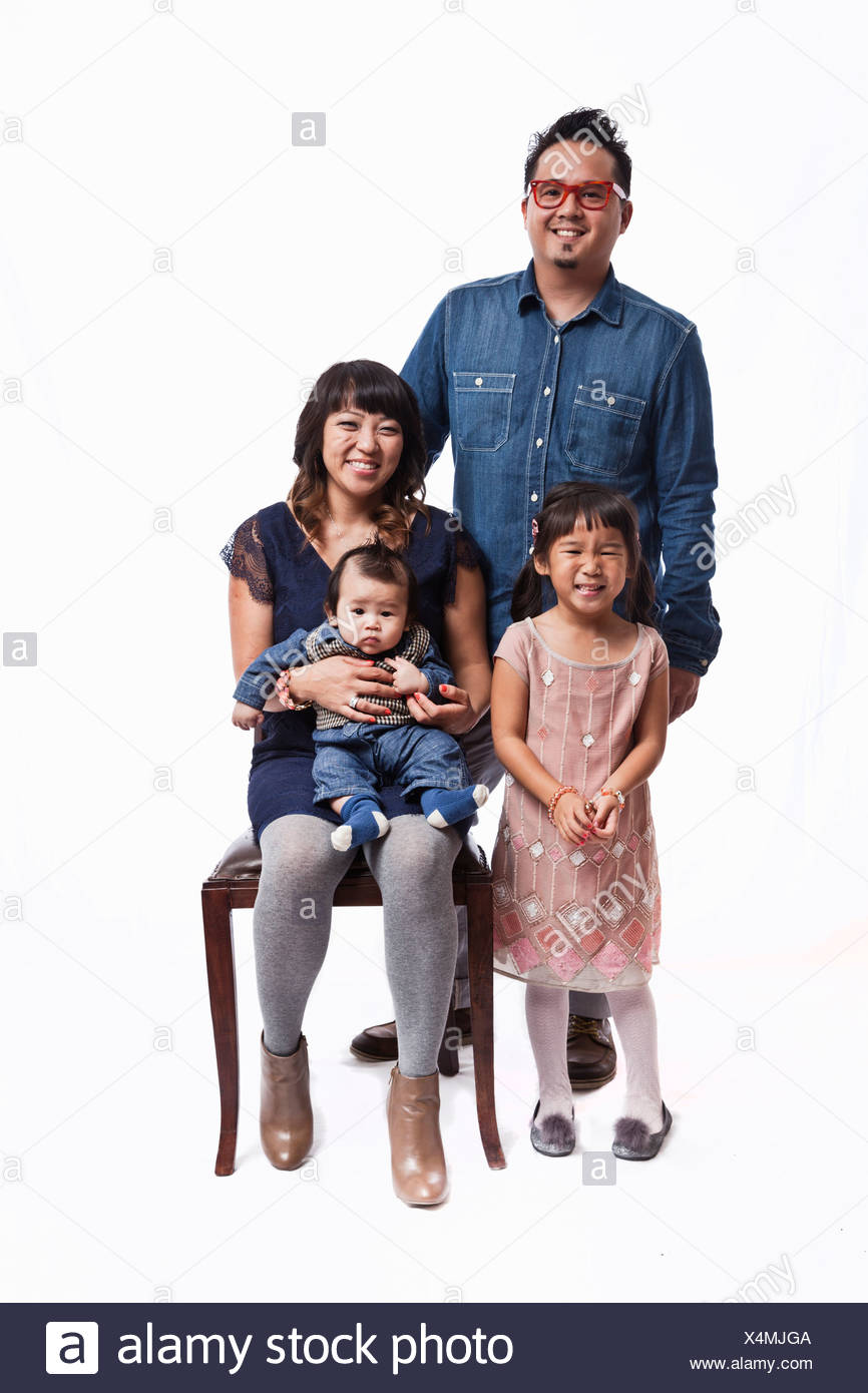 Family portrait of mid adult couple with daughter and baby boy - Stock Image