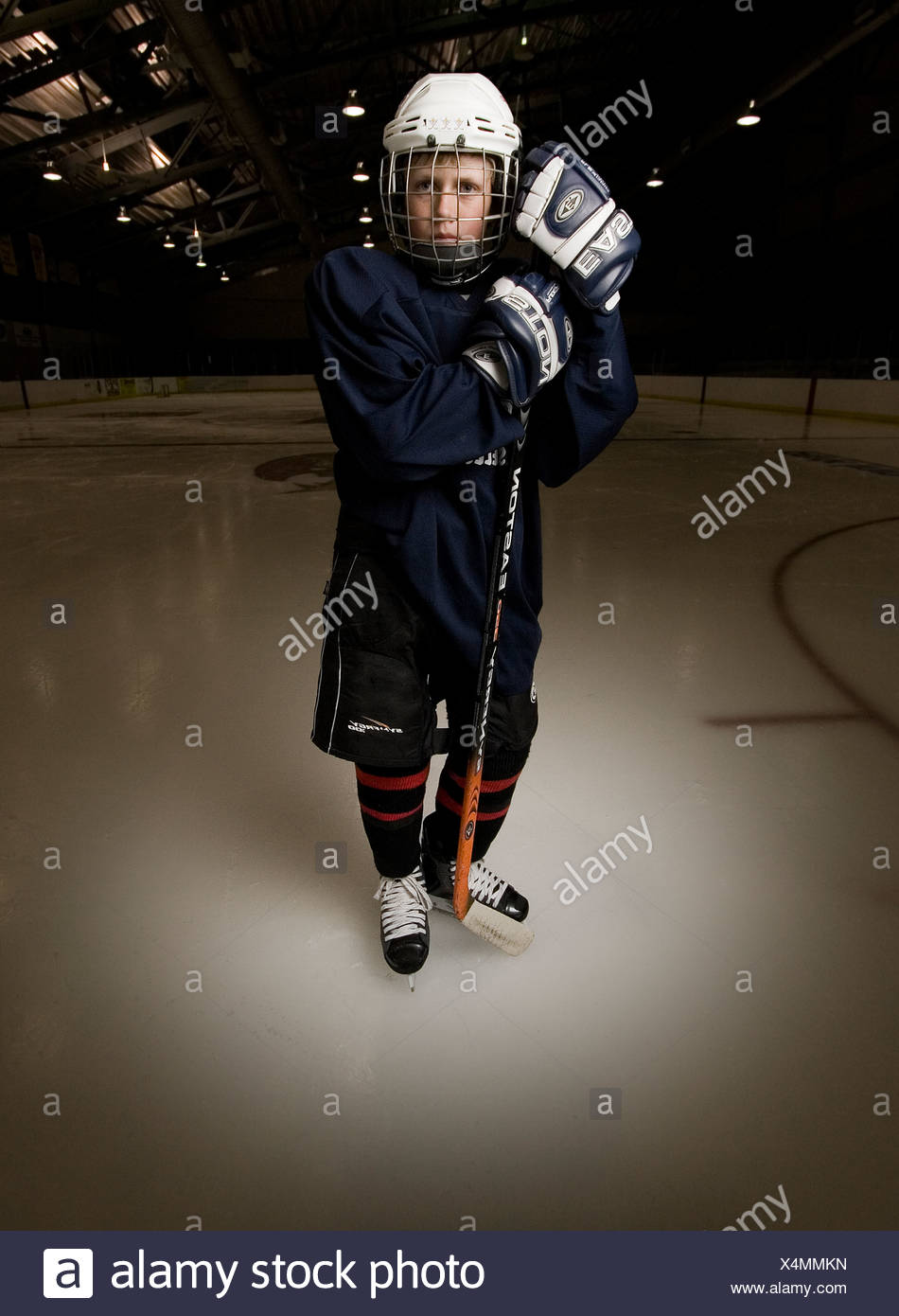 Nathaniel Werhane playing hockey and posing for a portrait in Santa Fe, New Mexico - Stock Image