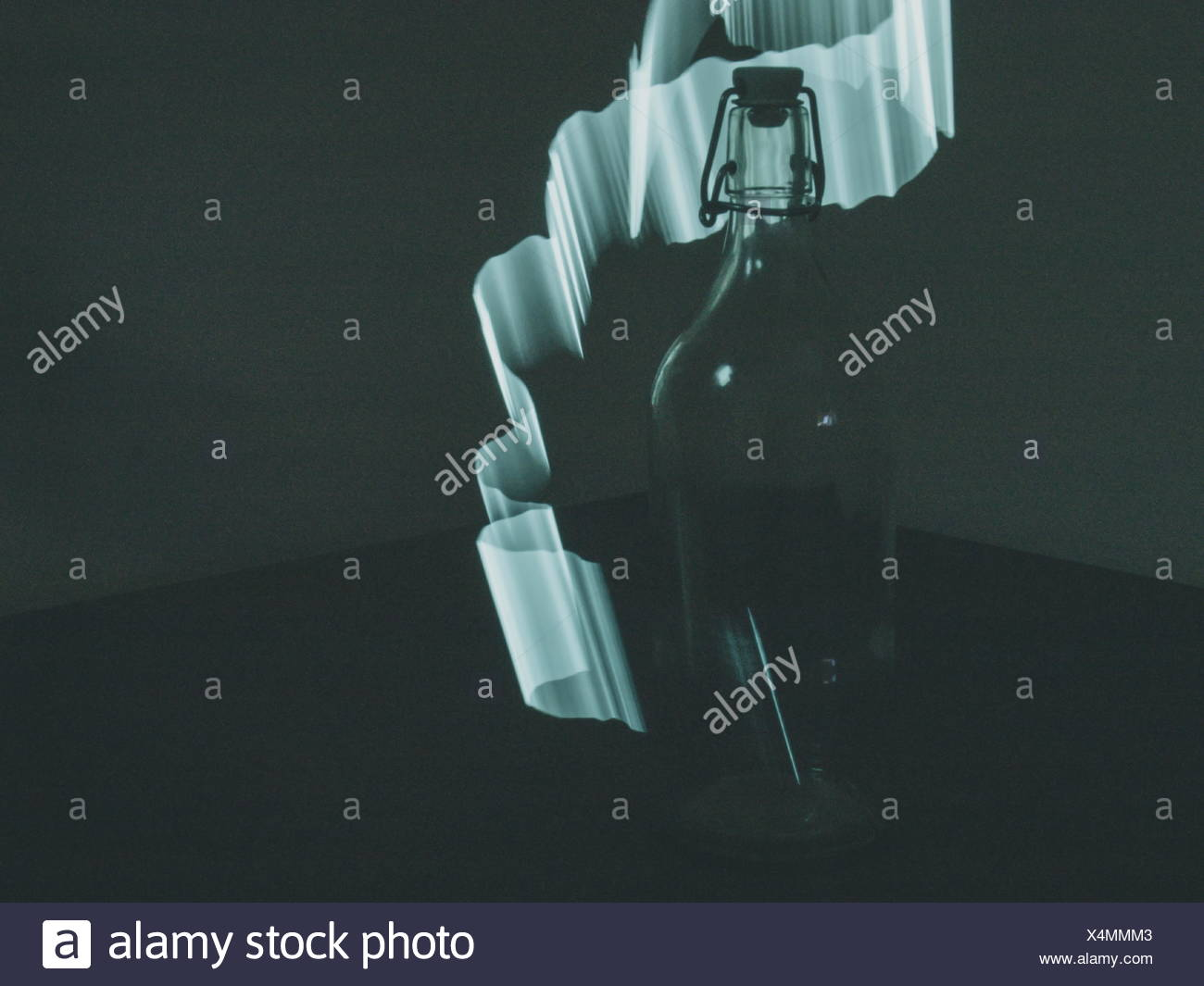 Empty Bottle And Light Trail - Stock Image
