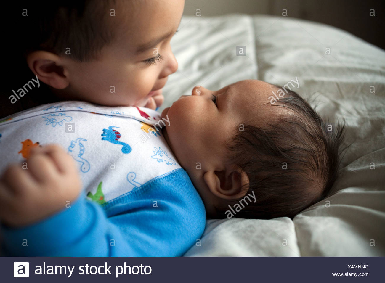 Boy with baby brother, close up - Stock Image